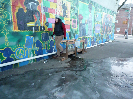 Debra crossing Astoria Scum River Bridge