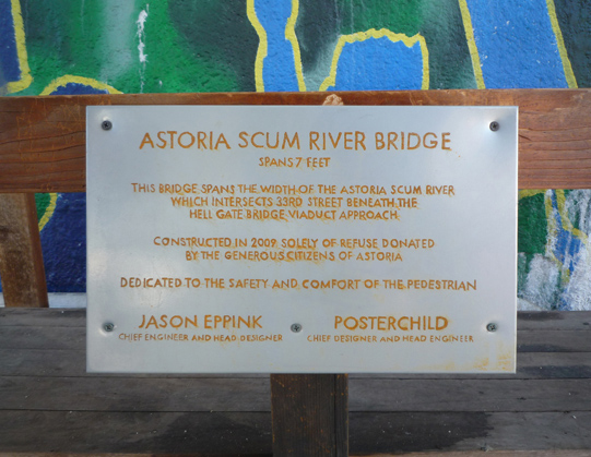 rusted Astoria Scum River Bridge plaque