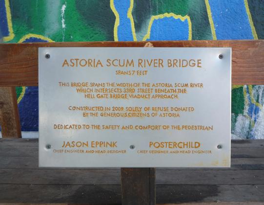 rusted Astoria Scum River Bridge plaque