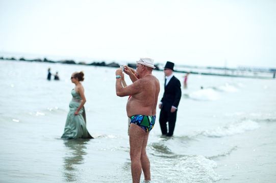 Speedo Man snaps a photo