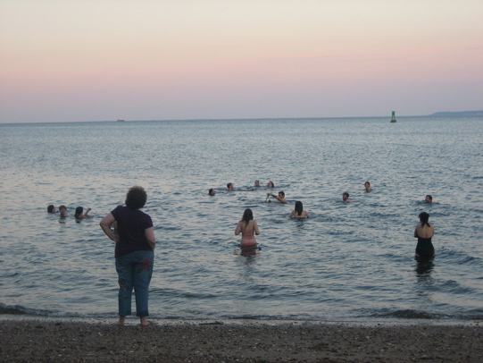 swimming at sunset