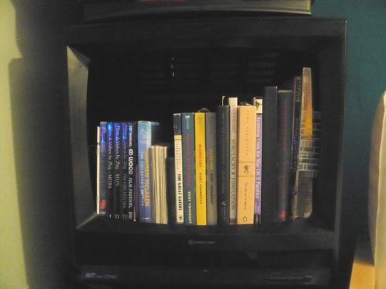TV bookshelf with books